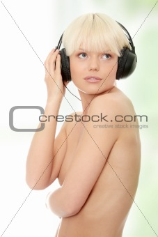 Attractive topless woman with headphones
