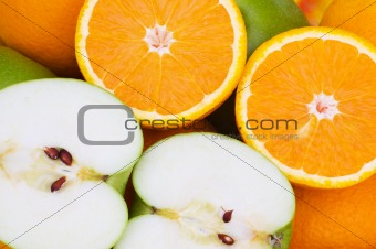 Close  up of half cut oranges and apples
