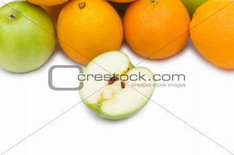 Apple and oranges isolated on the white background