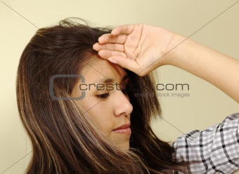 Beautiful Young Woman Holding Her Forehead