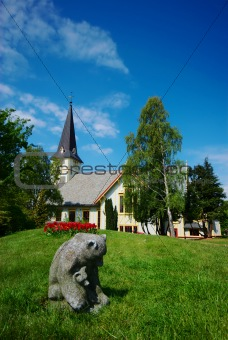 Bear Statue and White Church