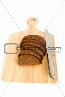 Bread and cutting board isolated on white