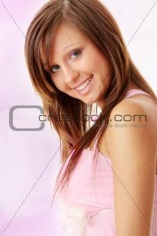 Beautiful brunette girl in sweet pink.