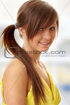 Beautiful brunette girl in yellow dress
