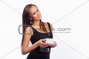 Beautiful young girl drinking coffee or tea