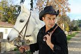 Cowboy with white horse and handgun