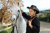 Cowboy petting his horse