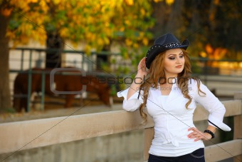 Cowgirl  near a fence