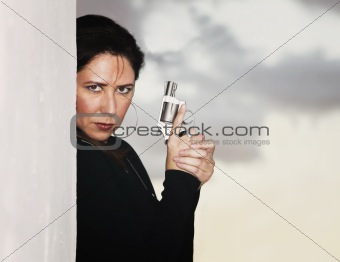 Hispanic Woman with Handgun