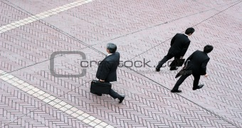 Three business men walking