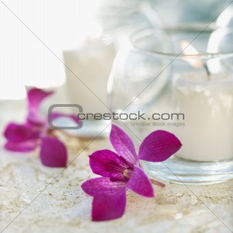 Lit candles and orchids.