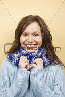 Woman wearing scarf.