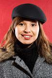 Woman in flat hat.
