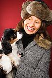 Woman holding dog.