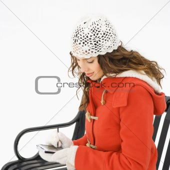 Sitting woman with PDA.