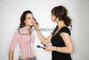 Makeup artist and woman.