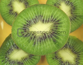 kiwis on a yellow plate