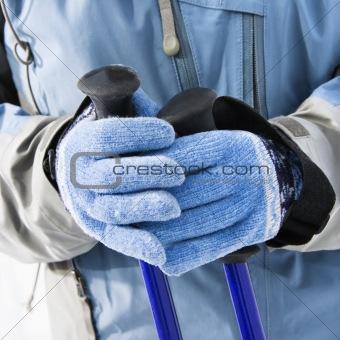 Ski gloves and poles.