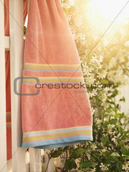 Towel hanging on fence.