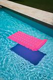 Pink float in  pool.