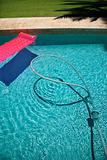 Float and vacuum in pool.