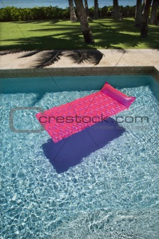 Float in swimming pool.
