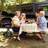 Family at picnic table.