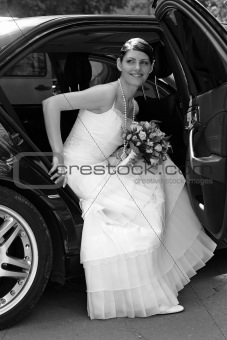 Portrait of a bride getting out of her wedding car