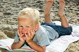 Boy Lying On A Beach