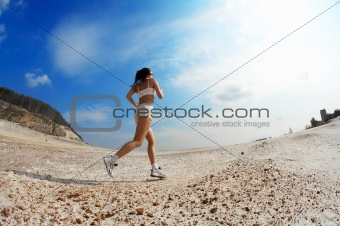 girl runs on sand