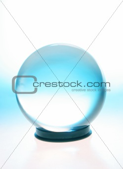 Crystal ball with bad of blue light