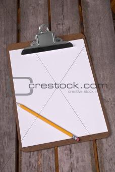Clip board with pencil