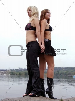 two beautiful young girls on the background of the river 1