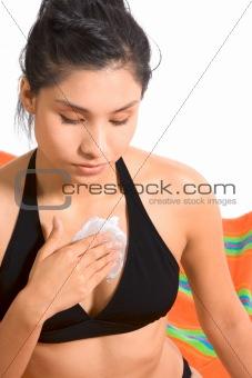 Applying sun lotion