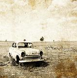 Old car at field. Photo in old image style.