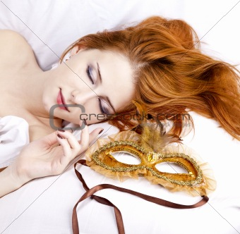 Sleeping woman near carnival mask.