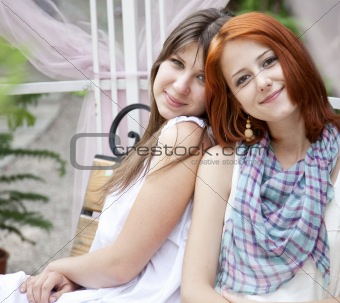 Portrait of two girls at outdoor.