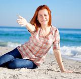 Happy red-haired girl at the beach.
