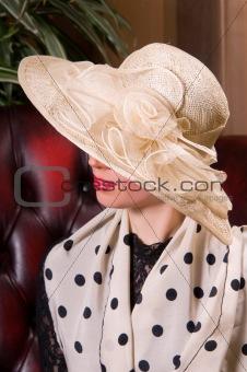 blond woman in an elegant hat