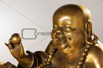 Ancient Figurine Cheerful Hotei.