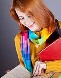 Young student girl with books.
