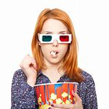 Women in stereo glasses eating popcorn.