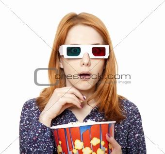 Women in stereo glasses eating popcorn.