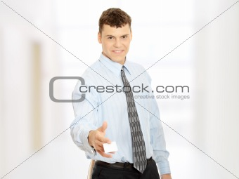 Business man with blank business card