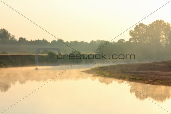 fishing on river in fog