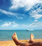 man foots on beach