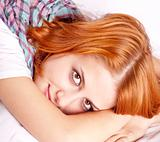 Pretty red-haired sleeping woman