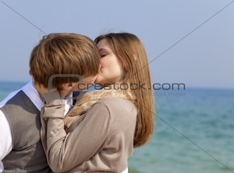 Couple kissing at spring sea.