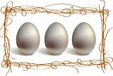 Three silver eggs in the nest frame