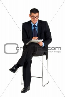 sitting businessman with eyeglasses writing